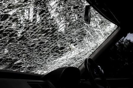 Damaged glass (car windshield) inside car photo