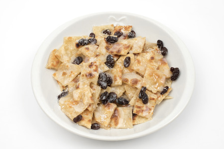 dollop: Indian roti with raisin and sweet sauce