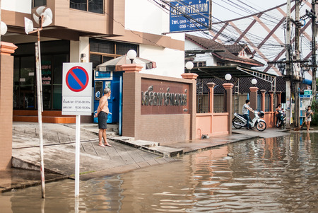 thailand flood: SRIRACHA, THAILAND - APRIL 12 : Road with flood after raining on 12 April 2015 in Sriracha, Chonburi, Thailand Editorial