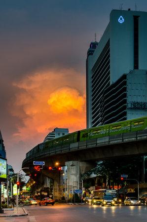 silom: BANGKOK, THAILAND - MAY 5 : Silom -  Naradhiwas Rajanagarindra junction traffic with nice cloudy sky on 5 May, 2014 in Bangkok, Thailand Editorial
