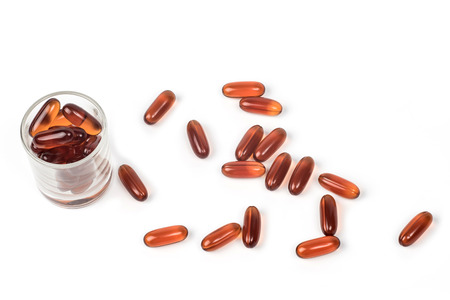 heathy diet: Oil capsules isolated, Drug time Stock Photo