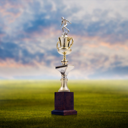 Football trophy with nice landscape background Success concept photo