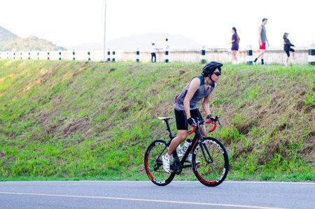 chonburi: CHONBURI THAILAND  APRIL 26 : Unidentified cyclist cycling uphill on 26 April 2014 in Chonburi Thailand