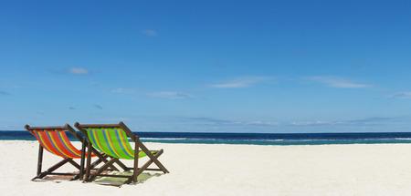 Beach chair on sand beside nice sea, Summer time concept