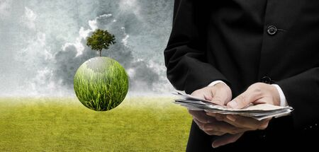 global trade: Businessman pay for green business Sustainable business concept Stock Photo