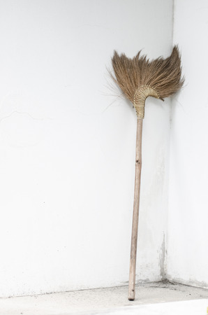 besom: Broom beside wall Rest concept