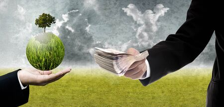 pay for: Businessman pay for green technology, Sustainable buisness concept Stock Photo