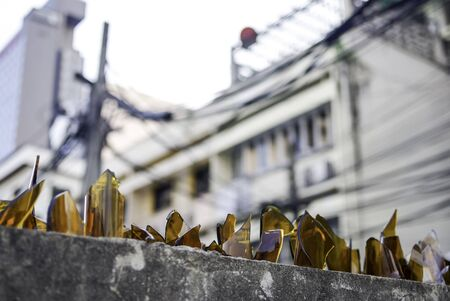 glass fence: Broken bottles glass on top of fence, Thailand Stock Photo