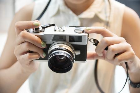 viewfinder vintage: Hipster girl take a photo with vintage camera