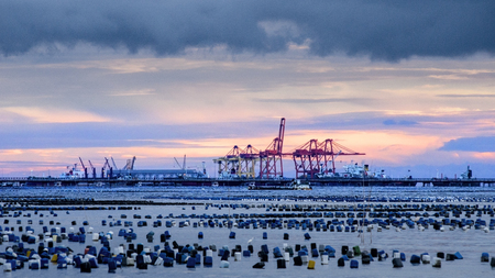 deepsea: CHONBURI, THAILAND - SEPTEMBER 11 : Shipping port with sunset sky at Laem Chabang deep-sea container port on 11 September 2015 in Sriracha, Chonburi, Thailand