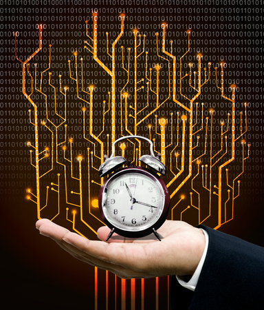 time machine: Time machine concept, Clock on hand with circuit board graphic background