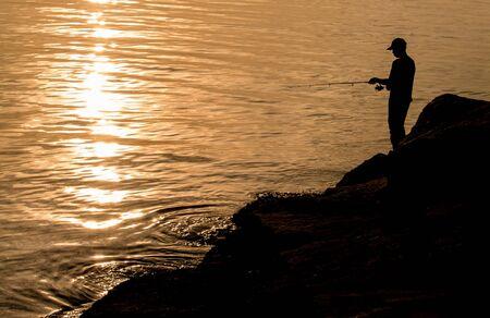 man fishing: Man fishing at sea, Thailand