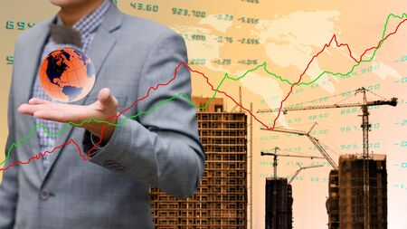 global economy: Global economy concept, Businessman carry the globe with construction site background Stock Photo