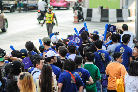 temporarily: Bangkok, Thailand - May 19, 2016 - Leicester City Supporter waiting for Leicester City Team parade to celebrate First Championship of English Premiere League 2015-16 Editorial