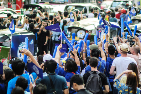 temporarily: Bangkok, Thailand - May 19, 2016 : Leicester City Supporter waiting for Leicester City Team parade to celebrate First Championship of English Premiere League 2015-16
