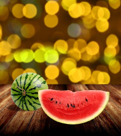tabel: Watermelon on wooden tabel with yellow bokeh light background