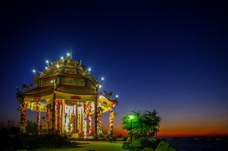 CHONBURI, THAILAND - DECEMBER 8 : Chinese temple with twilight sky on 8 December 2015 in Sriracha, Chonburi, Thailand