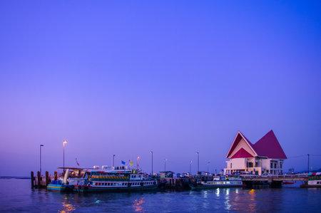 passenger ships: CHONBURI, THAILAND - DECEMBER 9 : Passenger ships at jetty with twilight sky on 9 December 2015 in Sriracha, Chonburi, Thailand