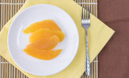 ready to eat: Dried mango in white dish ready to eat (Top view) Stock Photo