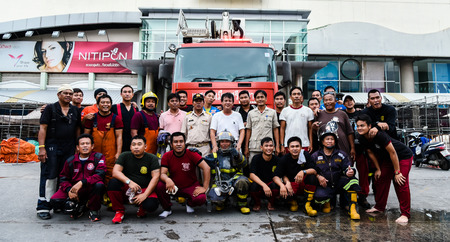 chonburi: SRIRACHA - OCT 12: Group of  fireman portrait after fire hydrant of Robinson Sriracha shopping mall on October 12, 2016 in Sriracha, Chonburi, Thailand Editorial