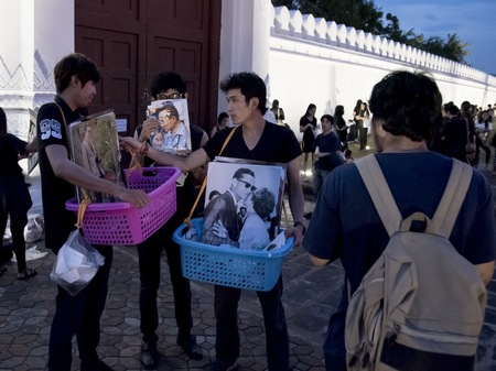 BANGKOK THAILAND - OCTOBER 16 : People share picture of King Rama 9 for commemorate at the Temple of the Emerald Buddha, Bangkok, Thailand on 16 October, 2016
