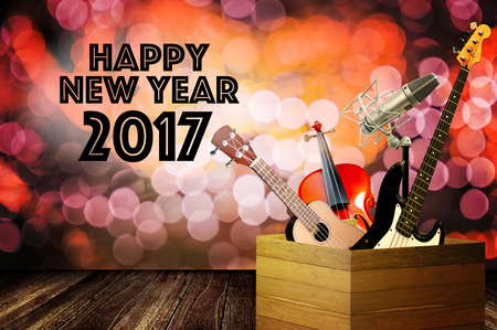 Music instrument with happy new year greeting word and bokeh background