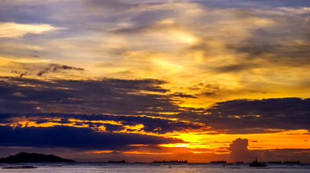 dramatic sky: Nice landscape, Dramatic sky at sea with cargo ship silhouette Stock Photo