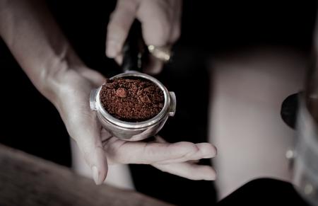 Coffee powder in espresso scoop, Focused at coffee scoop Stock Photo