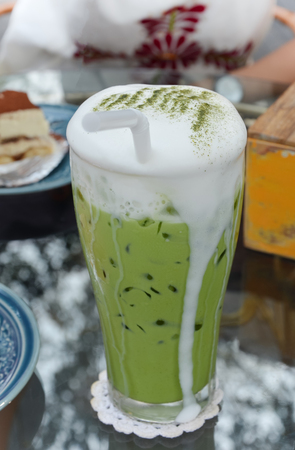 Matcha green tea with milk, Cold drink on table