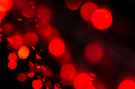 Red Bokeh light background, Christmas light decoration with defocused