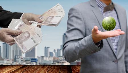 Businessman make money fropm wind farm project in hand 版權商用圖片