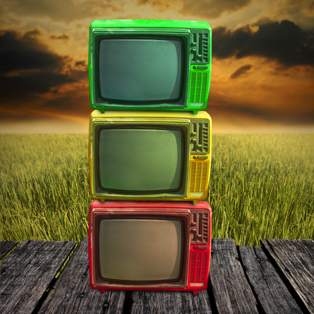 Retro television overlap on wooden deck with farmland background