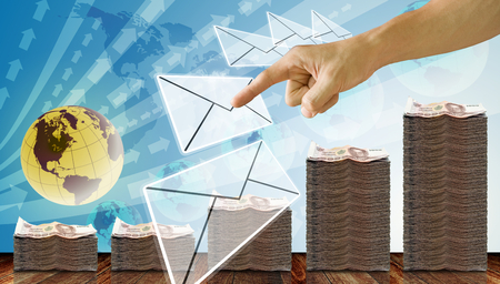 Finger pointing on e-mail with Thai money on deck background, Succes concept
