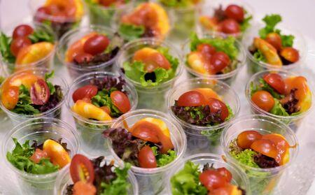 Delicious salad in plastic cup
