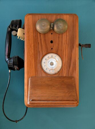 Vintage telephone hanging on a wall