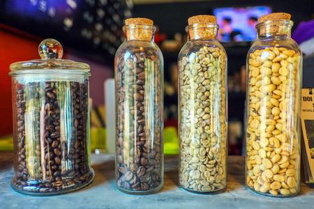 Coffee beans in bottles