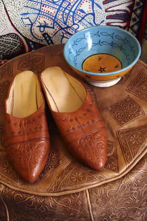 Still life, souvenirs from Morocco, slippers, leather pouf, traditional ceramics