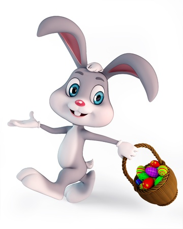 chocolate eggs: cute easter bunny carring a basket with colorful egg Stock Photo