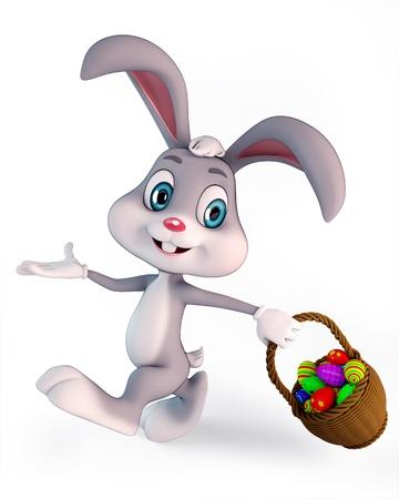lapin blanc: mignon lapin de P�ques carring un panier avec des oeufs color�s Banque d'images