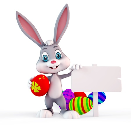 cute Easter bunny with colorful eggs and white board photo