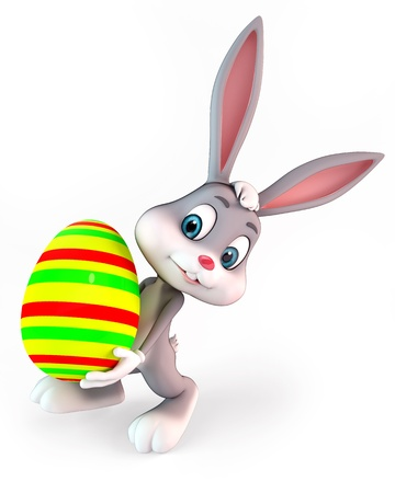 cute easter bunny carring a colorful egg Stock Photo
