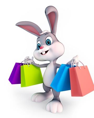 lindo conejo de Pascua con bolsas de compras Foto de archivo
