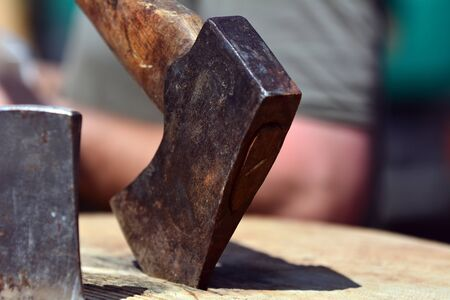 two ax stuck in a block of wood C