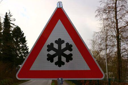 Road sign: beware of snowfalls Stock Photo