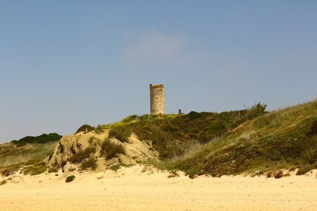 Old tower in the dunes of Chiclana de la Frontera in Andalucia
