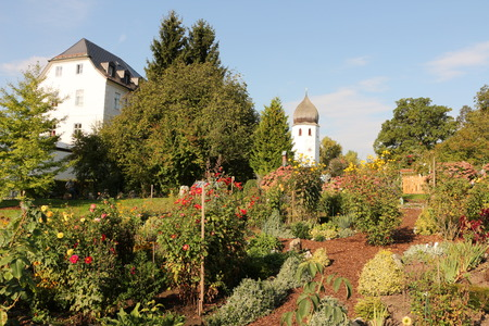 View of the monastery Frauenw?rth with monastery garden on the Fraueninsel in the Chiemsee