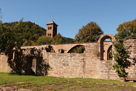 View of the old cloister of Hirsau Monastery in the Black Forest. In the background an old church tower.