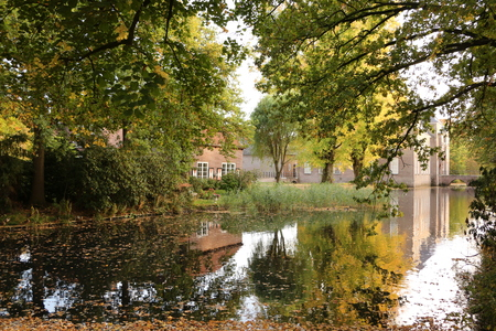 View of the moat of the moated castle of Heeze Castle in Heeze, a small town in the province of North Brabant in the Netherlands