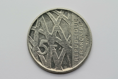 Front of the former 5 franc coin from France