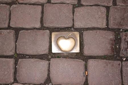Golden apple jewel stone in the pavement of Frankfurt city center